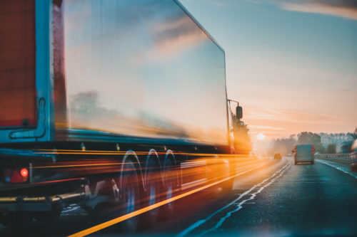 a semi-truck driving through Baton Rouge, LA
