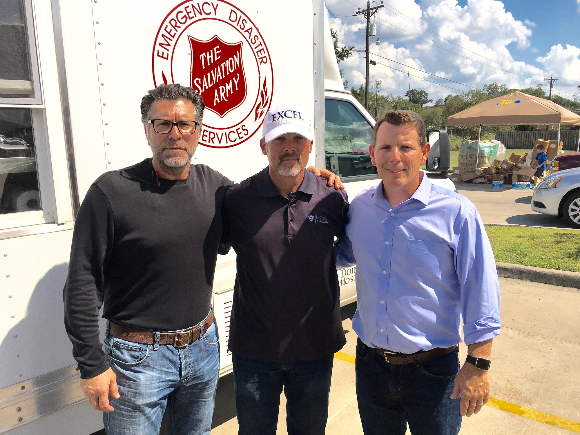 Attorneys Andre Gauthier and Jody Amedee with Chuck Robb, Head Pastor of St. Amant Church