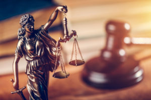 Lady Justice on the desk of a personal injury lawyer