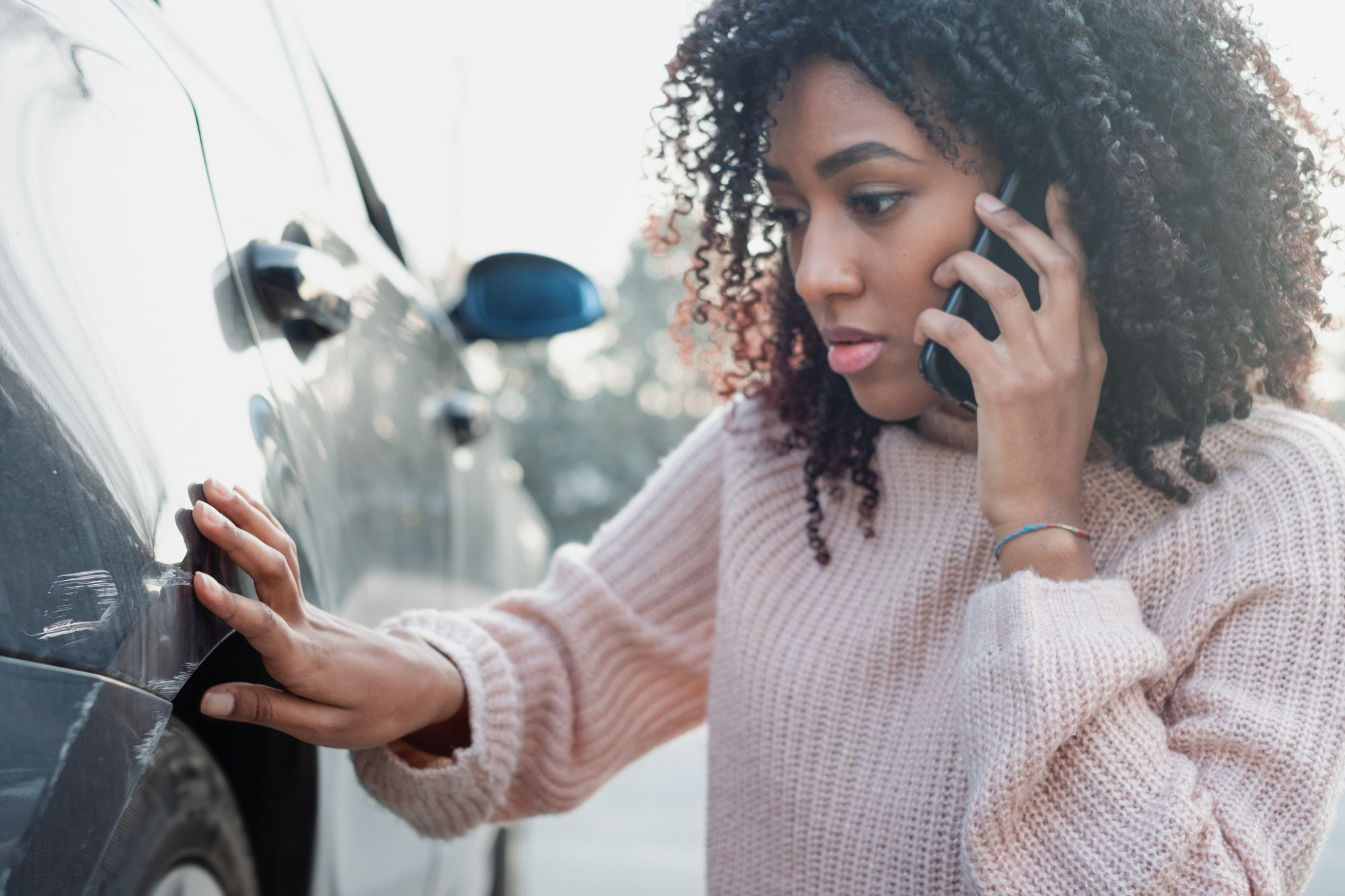 woman calling a car accident lawyer after an accident in Baton Rouge