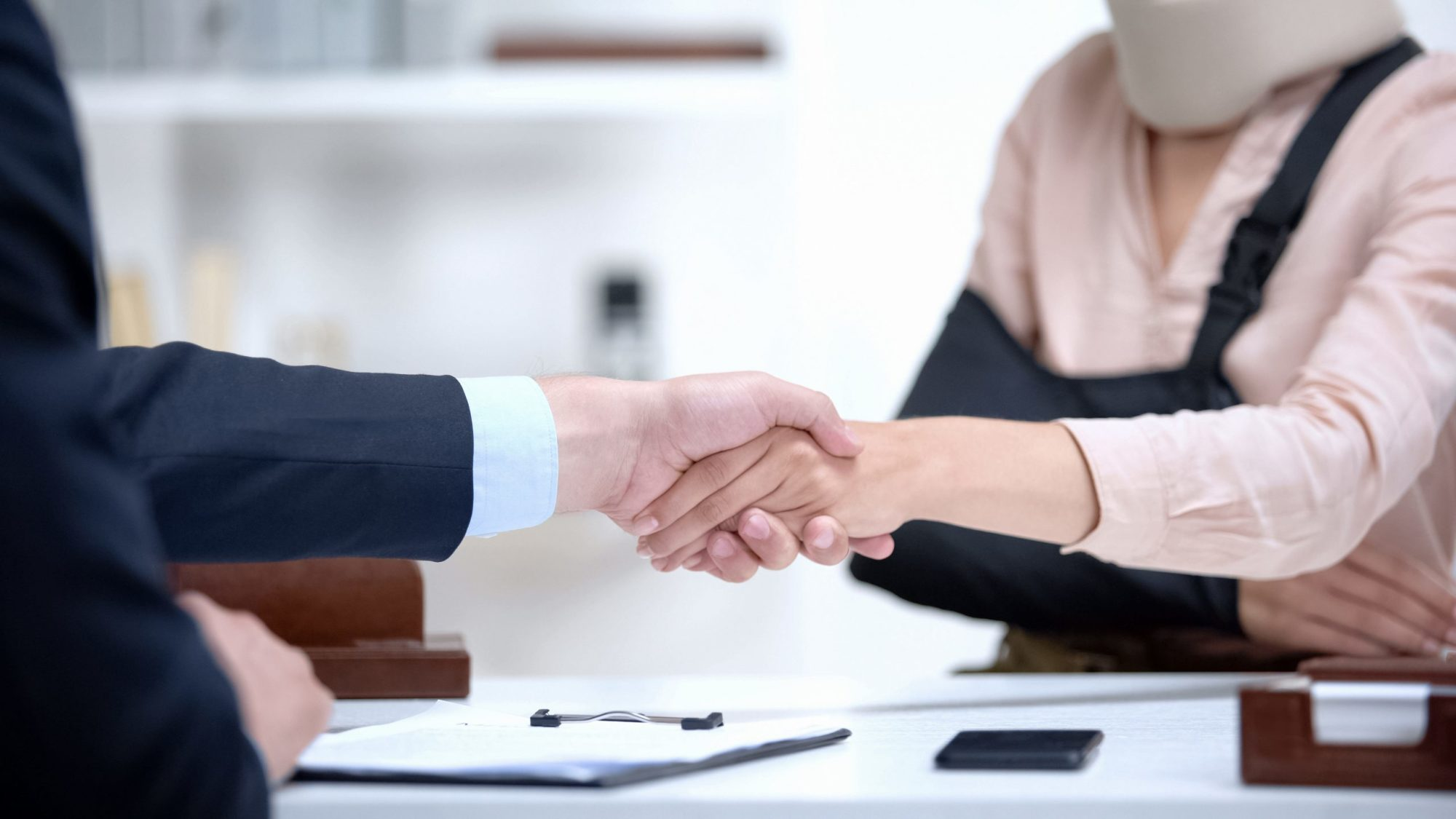 personal injury attorney shaking hands with client