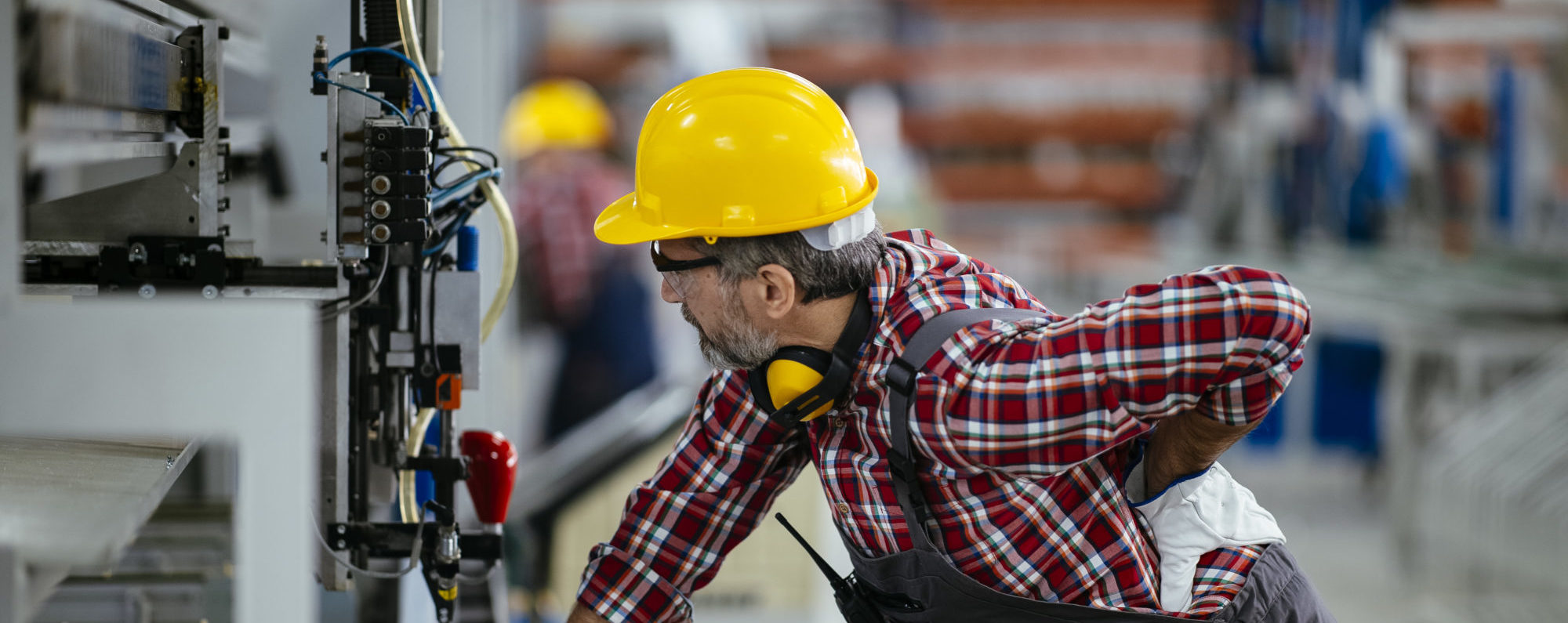 Factory worker with painful back injury stock photo