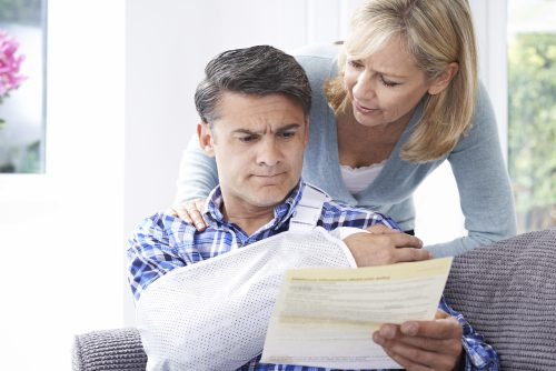 A couple reading through their personal injury claim in Ascension Parish