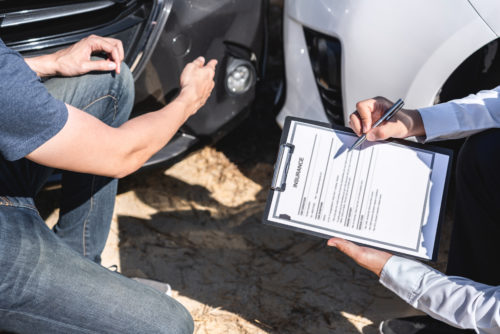an insurance adjuster going over a car accident claim
