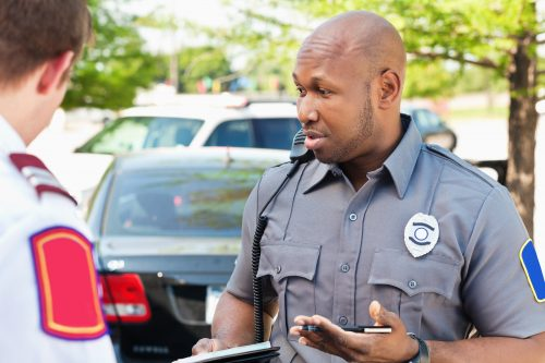 a police officer taking statements after a car accident in Baton Rouge